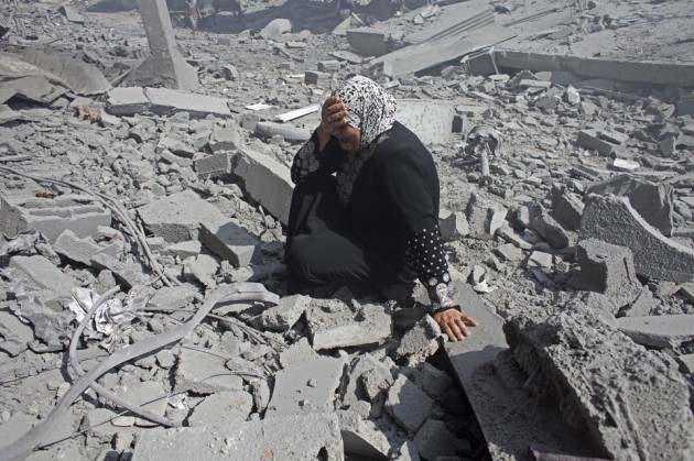 Gaza woman returns to flattened home