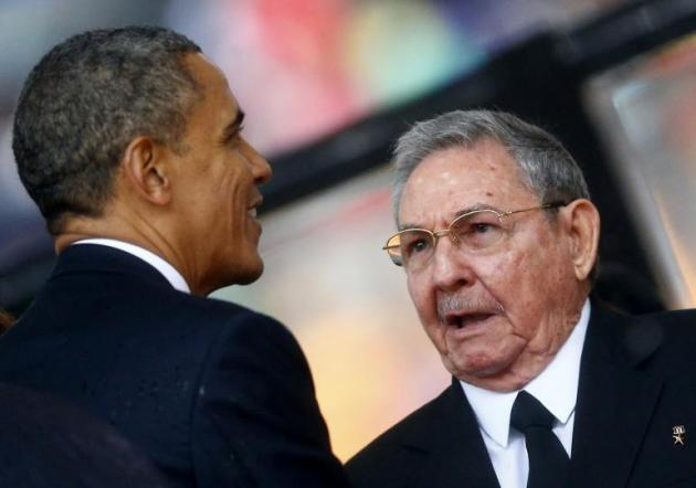 EMBARGOS TO AMIGOS: Obama with Cuban President Raul Castro