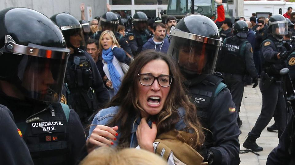 catalonia referendum-police seizewoman